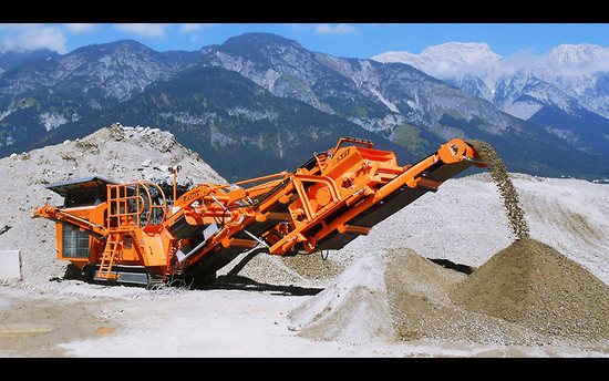 The compact power crusher R700S in use for recycling and aggregate processing projects in Tyrols mountains